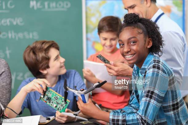 junior high age school students build robot, drone in technology, engineering class. - junior high student stock pictures, royalty-free photos & images