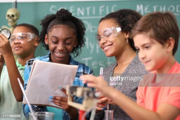 junior high age school students conduct science experiments in classroom. - aluna da escola secundária imagens e fotografias de stock