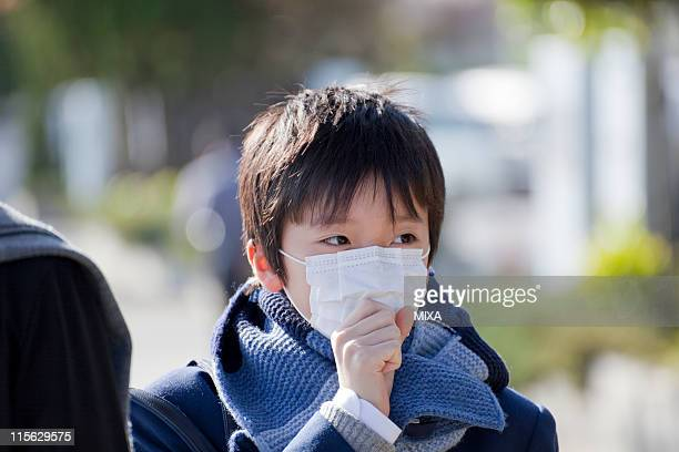 Junior High School Boy with Mask Standing and Coughing