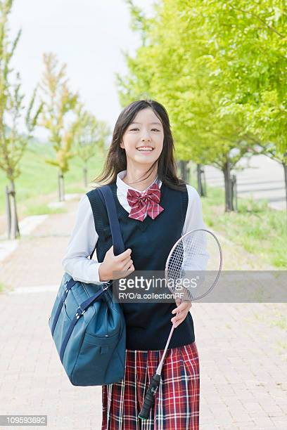 Junior High School Carrying Badminton Racket