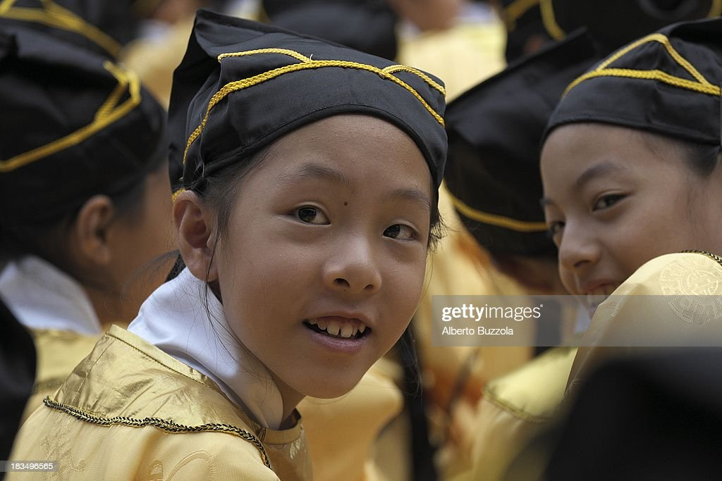 A junior high school student at an event to commemorate the 2563rd birthday of China's most revered sage Confucius at the Taipei Confucius Temple. Confucius Birthday is also known in Taiwan and in the Chinese speaking world as Teacher's day..