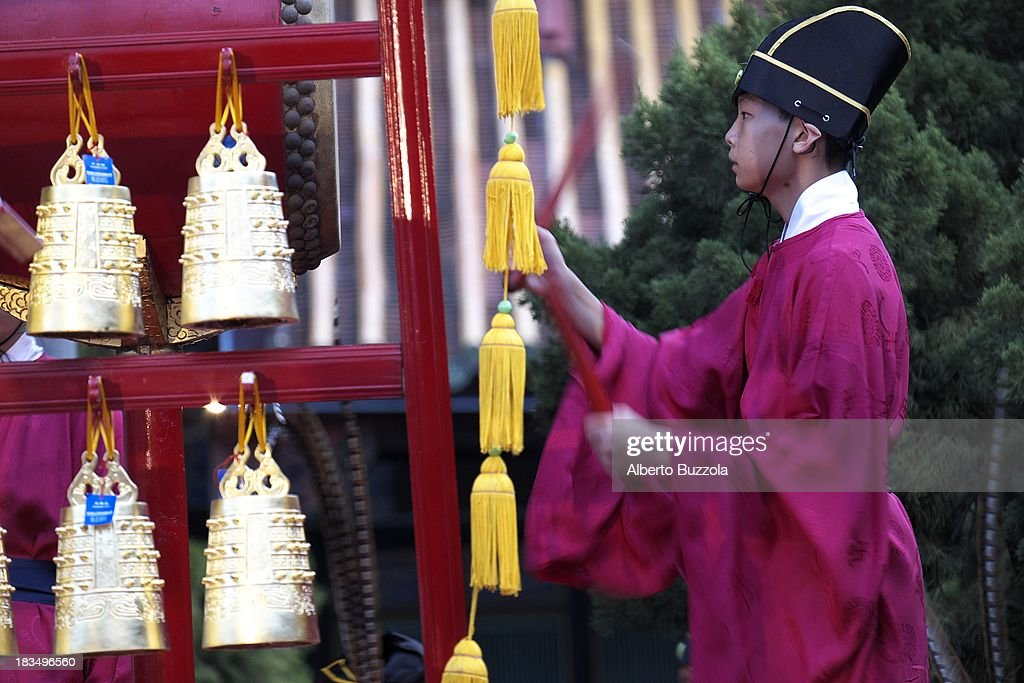 A junior high school student bangs a drum to signify the start of an event to commemorate the 2563rd birthday of China's most revered sage Confucius at the Taipei Confucius Temple. Confucius Birthday is also known in Taiwan and in the Chinese speaking world as Teacher's day..