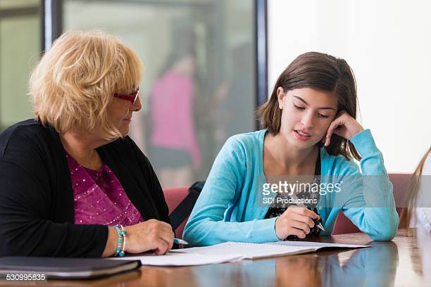 Junior high school student taking placement test with teacher