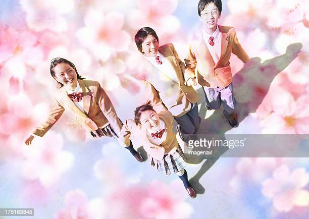 Junior high school students looking up and cherry blossoms