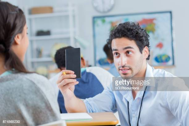 junior high school teacher takes smart phone from student - absence stock pictures, royalty-free photos & images