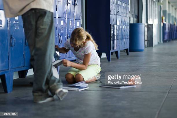 junior high student picking up dropped school supplies, boy standing by watching - low section stock pictures, royalty-free photos & images