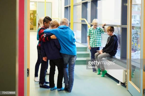 Junior high students in middle school corridor