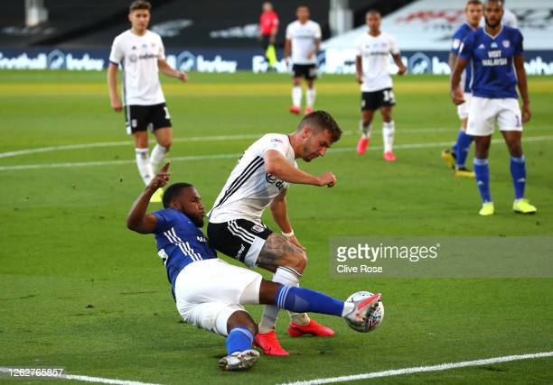 Junior Hoilett of Cardiff City and Joe Bryan of Fulham during the Sky Bet Championship Play Off Semifinal 2nd Leg match between Fulham and Cardiff...