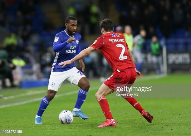 Junior Hoilett of Cardiff City FC and Yuri Ribeiro of Nottingham Forest during the Sky Bet Championship match between Cardiff City and Nottingham...