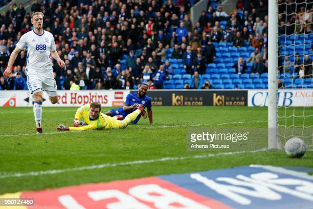 Junior Hoilett of Cardiff City has a shot on goal which rolls past David Stockdale of Birmingham City during the Sky Bet Championship match between...