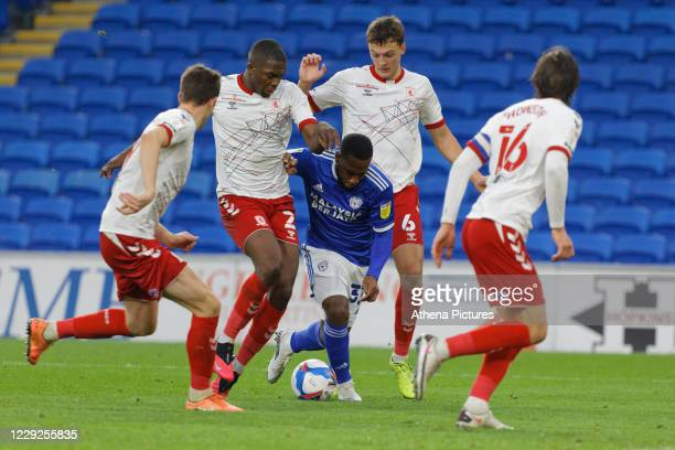 Junior Hoilett of Cardiff City is stopped by Anfernee Dijksteel and Dael Fry of Middlesbrough during the Sky Bet Championship match between Cardiff...