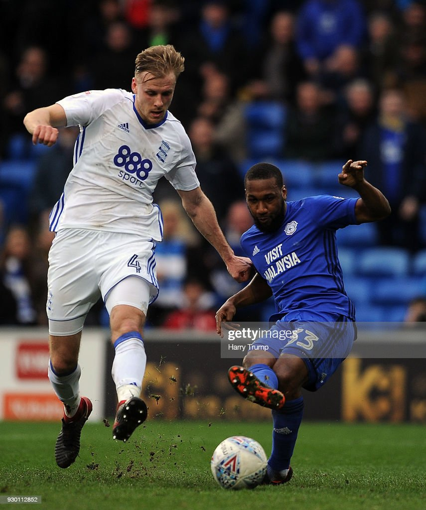 Junior Hoilett of Cardiff City is tackled by Marc Roberts of Birmingham City during the Sky Bet Championship match between Cardiff City and Birmingham City at the Cardiff City Stadium on March 10, 2018 in Cardiff, Wales.