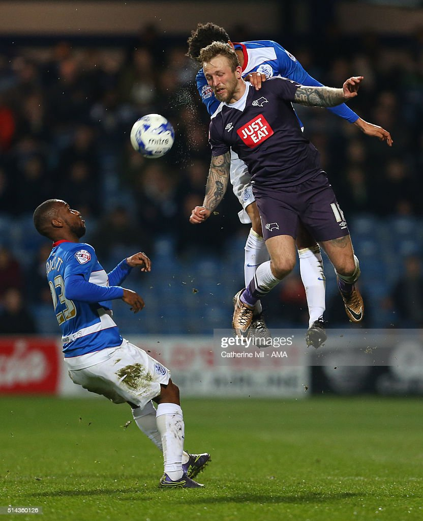 Junior Hoilett of Queens Park Rangers watches as Johnny Russell of Derby County and James Perch of Queens Park Rangers jump up during the Sky Bet Championship match between Queens Park Rangers and Derby County at at Loftus Road on March 8, 2016 in London, England.