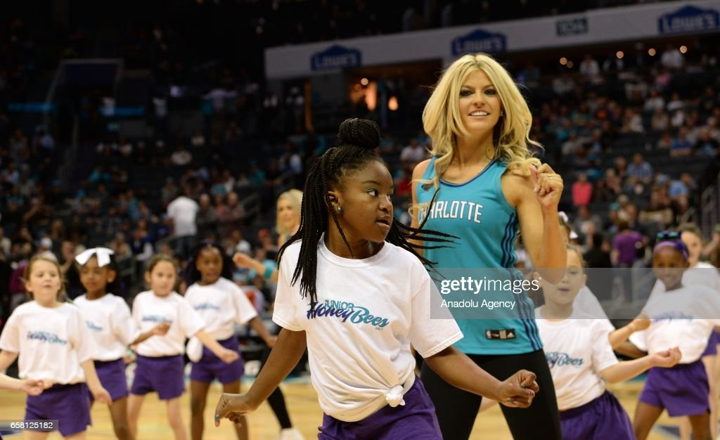 junior honeybees perform with the Charlotte Hornets honeybees in the halftime show during the NBA match between Phoenix Suns vs Charlotte Hornets at the Spectrum arena in Charlotte, NC, USA on March 26, 2017.
