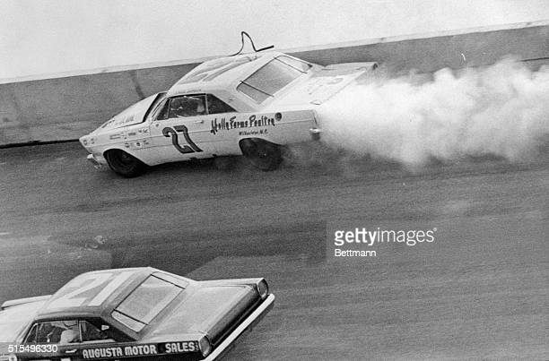Junior Johnson #27 leaves a trail of smoke as he bounces off wall in early lap of Daytona 500 here 2/14 Marvin Panch in drives past into the lead
