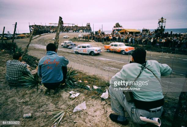 Junior Johnson in the Pontiac car and Charlie Cregar in the Chevrolet car race as fans watch the action during the Daytona Beach and Road Course on...