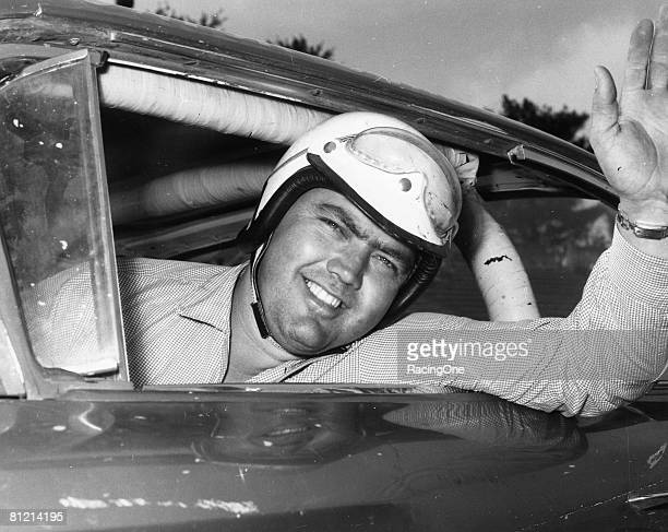 Junior Johnson looks out his car window before a race Johnson racked up 50 wins during his NASCAR Cup Series driving career being named one of the...