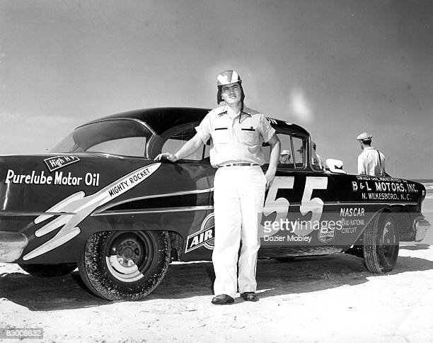 Junior Johnson poses on the beach with his BL Motors 1955 Oldsmobile before the Beach and Road Course race on February 27 1955 at the Beach and Road...