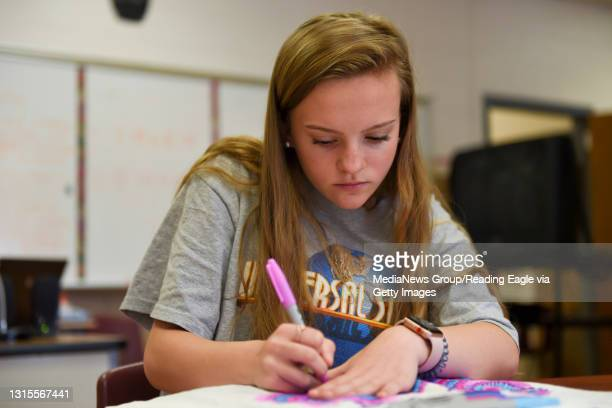 Junior Kaitlyn Sharpley works on a Sharpie tie-dye t shirt Thursday during 'Student Seminars' at Governor Mifflin High School. Photo by Lauren A....