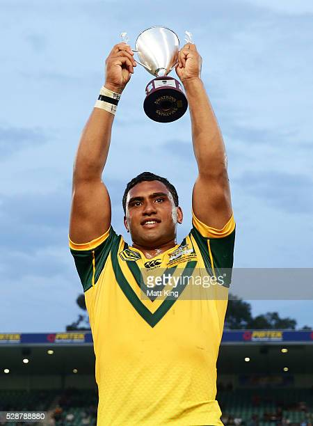 Junior Kangaroos captain Tevita Pangai lifts the winners trophy during the International Rugby League match between the Junior Kangaroos and the...