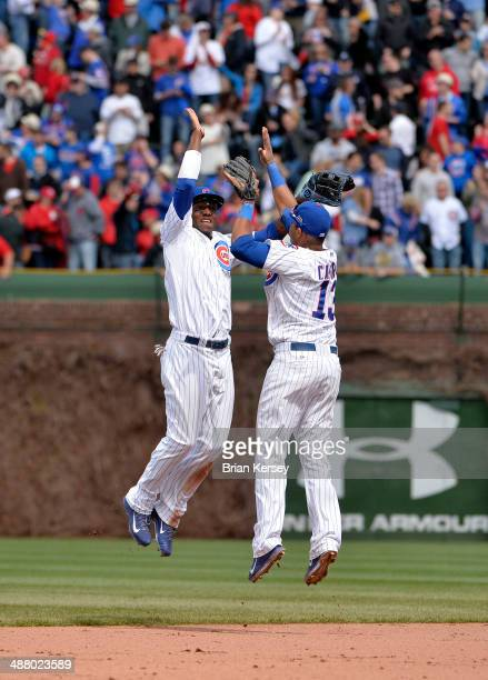 Junior Lake and Starlin Castro of the Chicago Cubs celebrate their win over the St. Louis Cardinals at Wrigley Field on May 3, 2014 in Chicago,...