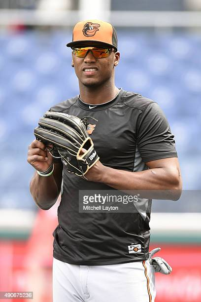 Junior Lake of the Baltimore Orioles looks on during batting practice of a baseball game against the Washington Nationals at Nationals Park on...