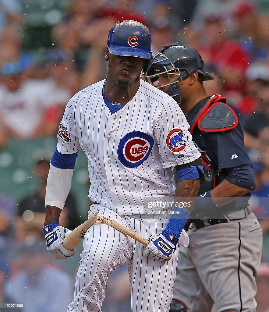 Junior Lake #21 of the Chicago Cubs breaks his bat over his leg after striking out with the bases loaded in the 6th inning against the Atlanta Braves at Wrigley Field on July 11, 2014 in Chicago, Illinois.