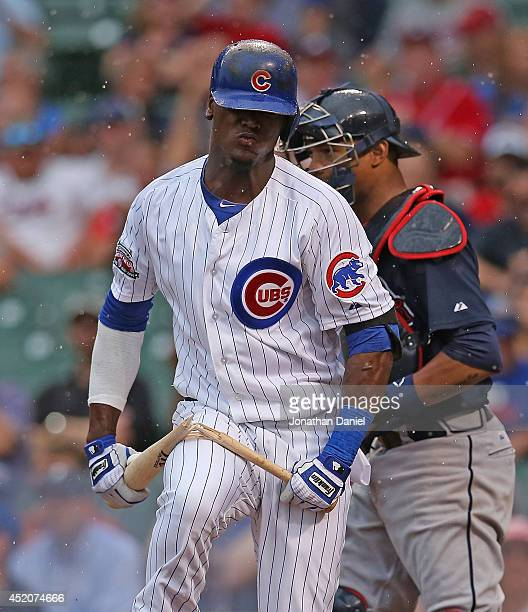 Junior Lake of the Chicago Cubs breaks his bat over his leg after striking out with the bases loaded in the 6th inning against the Atlanta Braves at...
