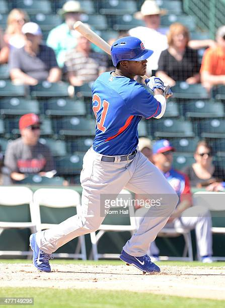 Junior Lake of the Chicago Cubs follows through on a swing against the Anaheim Angels at Tempe Diablo Stadium on March 7 2014 in Tempe Arizona
