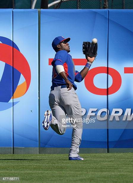 Junior Lake of the Chicago Cubs makes a running catch in the outfield against the Anaheim Angels at Tempe Diablo Stadium on March 7 2014 in Tempe...