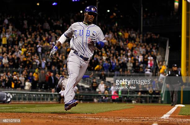 Junior Lake of the Chicago Cubs scores on an RBI single in the ninth inning against the Pittsburgh Pirates during the game at PNC Park April 2 2014...
