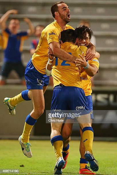 Junior Laloifi of Brisbane City celebrates a try with team mates during the 2014 NRC Grand Final match between Brisbane City and Perth Spirit at...