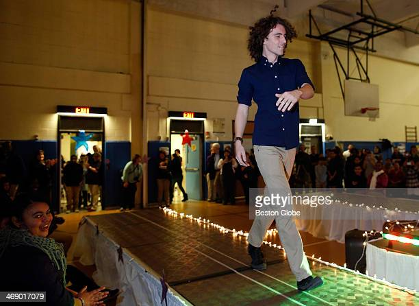 Junior Larry Barnes walks down the runway during a school fashion show of new dress policy options for the 20142015 school year at The Winter Hill...