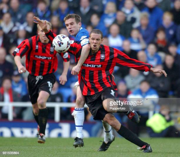 Junior Lewis of Brighton and Phil Parkinson of Reading battle for the ball during the Nationalwide League Division 2 match between Reading and...