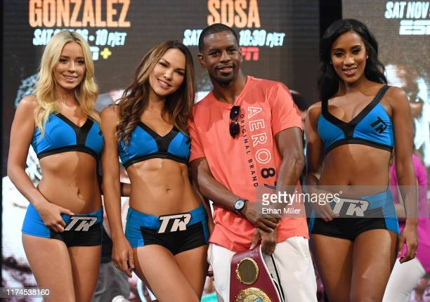 Junior lightweight champion Jamel Herring poses with ring girls Stephanie Ann Cook, CJ Gibson and Tianna Tuamoheloa during a news conference...