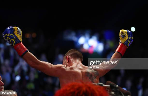 Junior Lightweight Champion Vasiliy Lomachenko celebrates his sixth round stoppage against Guillermo Rigondeaux at Madison Square Garden at Madison...