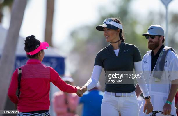 Junior Lucy Li shakes hands with playing partner Michelle Wie on the 9th hole during the second round of the 2017 ANA Inspiration at Mission Hills...