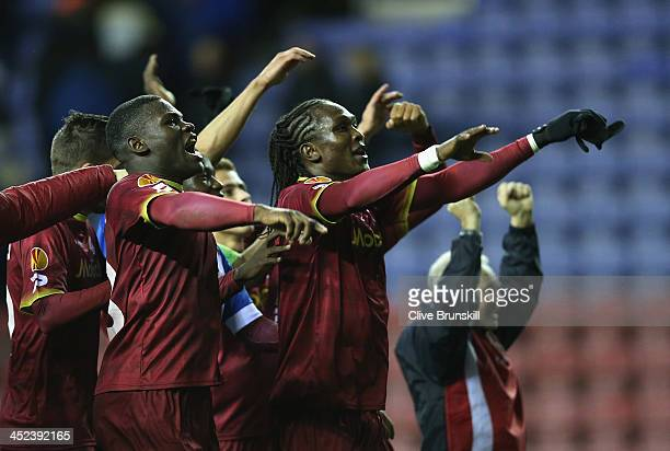 Junior Malanda of SV Zulte Waregem celebrates at the final whistle after scoring his teams second and winning goal during the UEFA Europa League...