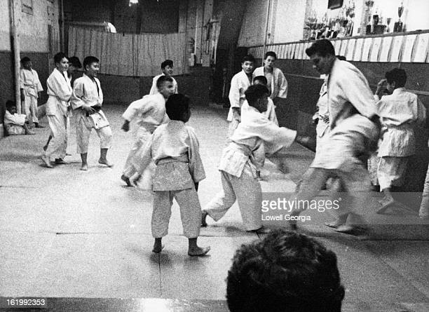 MAR 10 1961 3161961 Junior member of the Denver Judo Dojo limber up during a practice session for Sunday's seventh annual Rocky Mountain Regional...