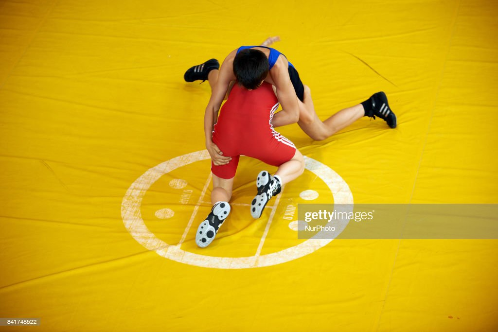 A junior member of the TOAC Wrestling Club (in blue) fights during the FSGT World Championship. On 1st September 2017 in Clermond-Ferrand, France.