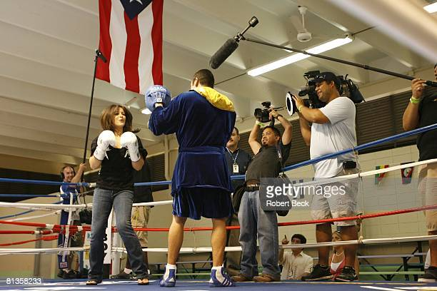 Junior Middleweight Boxing WBC champion Oscar De La Hoya with wife Millie Corretjer during workout for Floyd Mayweather Jr fight at Wilfredo Gomez...