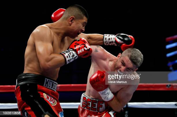 WBO junior middleweight champion Jaime Munguia battles with Liam Smith during the first round of their title fight on July 21 2018 in Las Vegas Nevada