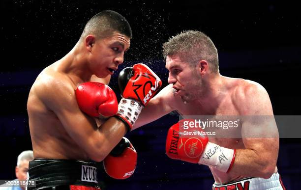 WBO junior middleweight champion Jaime Munguia of Mexico battles with Liam Smith of England during their title fight on July 21 2018 in Las Vegas...