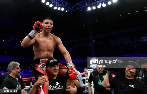 Yamaguchi Falcao of Brazil celebrates his victory over Elias Espadas of Mexico as referee Jay Nady looks on after a middleweight bout on July 21 2018...