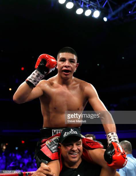 WBO junior middleweight champion Jaime Munguia of Mexico celebrates his unanimous decision victory over Liam Smith of England on July 21 2018 in Las...