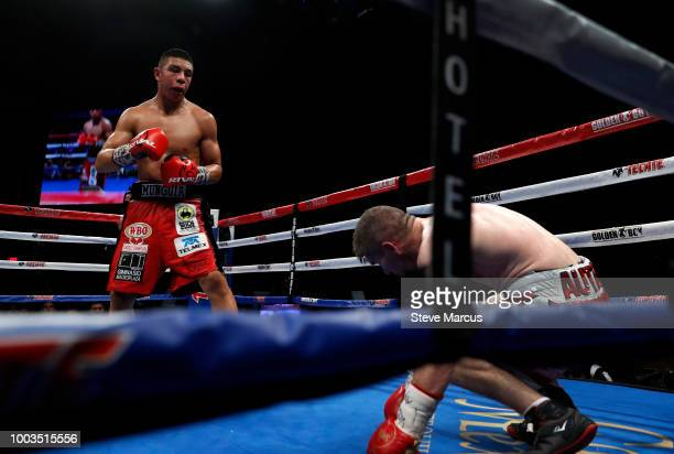 WBO junior middleweight champion Jaime Munguia of Mexico knocks down Liam Smith of England in the sixth round of their title fight on July 21 2018 in...