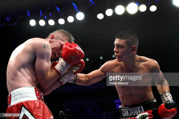 WBO junior middleweight champion Jaime Munguia of Mexico punches Liam Smith of England during their title fight on July 21 2018 in Las Vegas Nevada...
