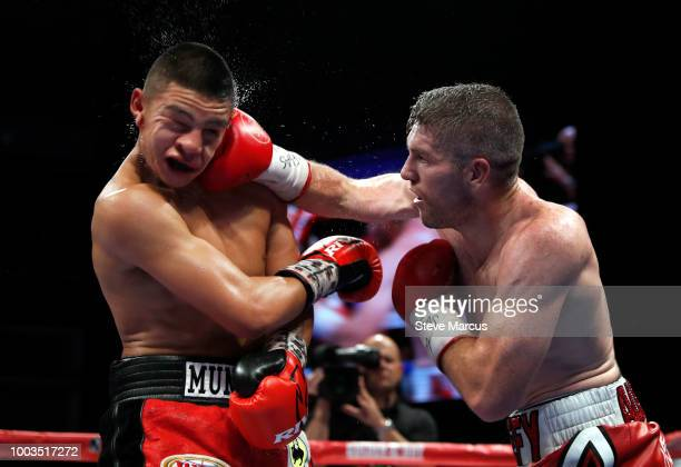 WBO junior middleweight champion Jaime Munguia of Mexico takes a punch from Liam Smith of England during their title fight on July 21 2018 in Las...