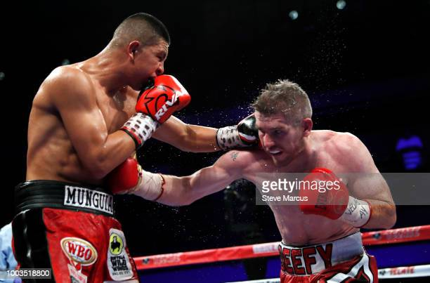 WBO junior middleweight champion Jaime Munguia of Mexico trades punches with Liam Smith of England during their title fight on July 21 2018 in Las...