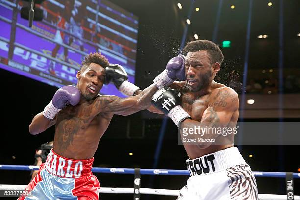 Junior middleweight champion Jermall Charlo and Austin Trout trade blows during their title fight at The Chelsea at The Cosmopolitan of Las Vegas on...